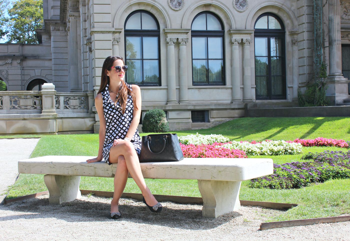 Brit Rose black and white ruffle dress for touring The Breakers in Newport, Rhode Island