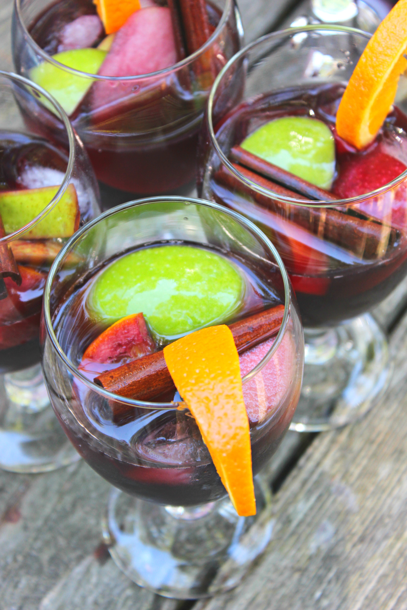 Easy Cinnamon Apple Autumn Sangria recipe with apples, pears, and oranges