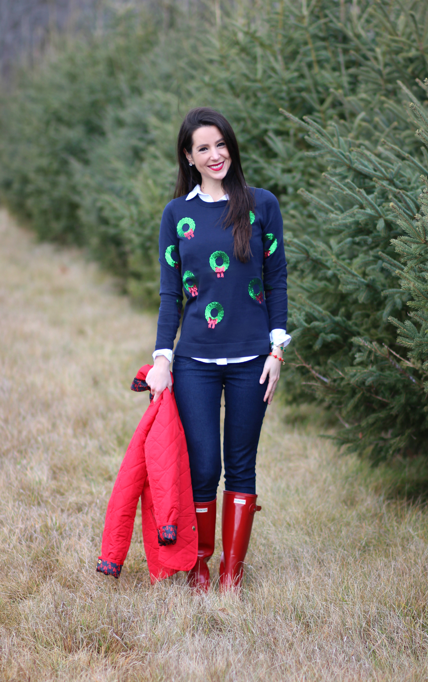 Cutting down our Christmas tree in the perfect affordable quilted red jacket from Crown & Ivory