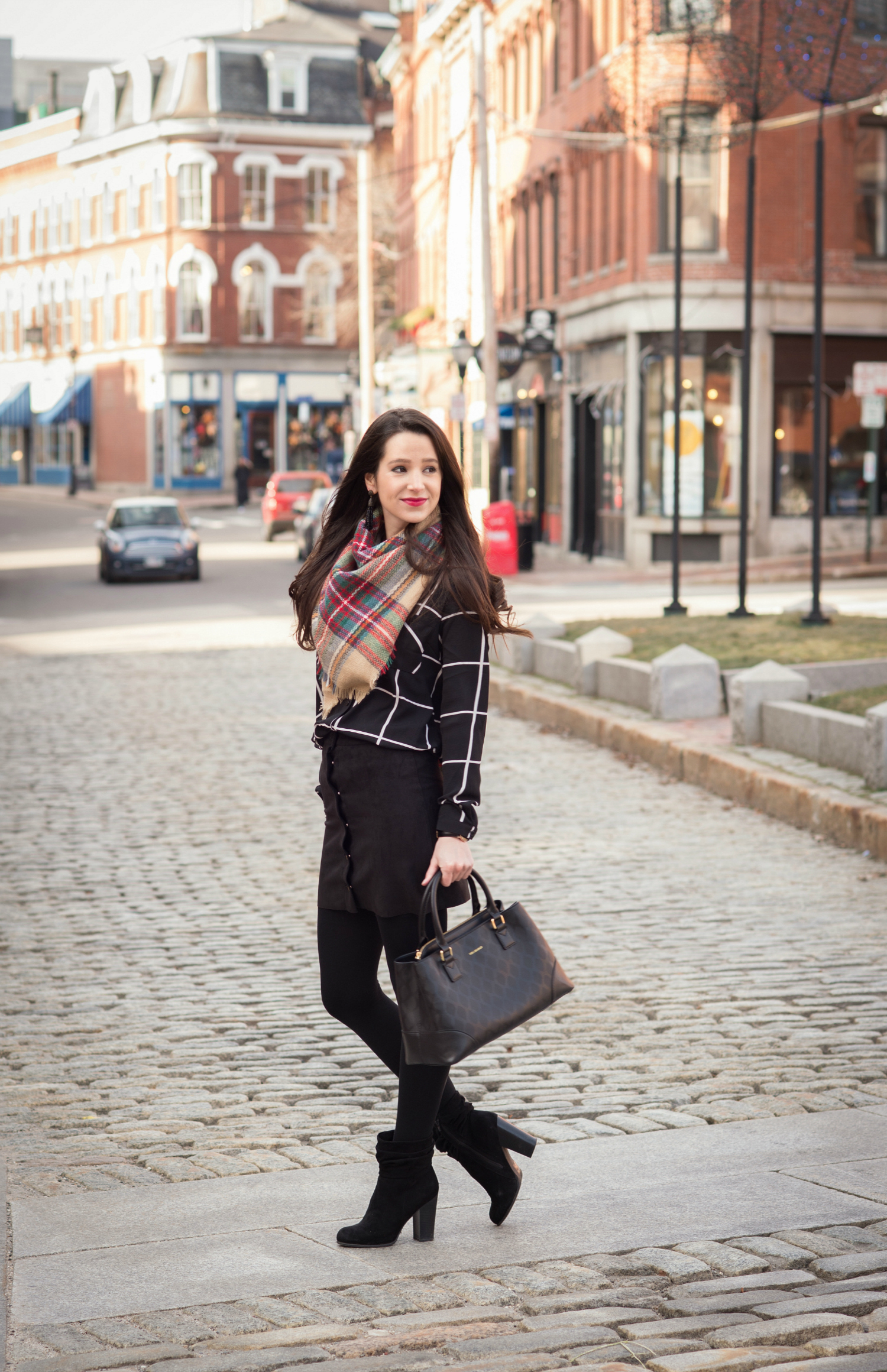 Chic all black winter outfit with a pop of color in the scarf