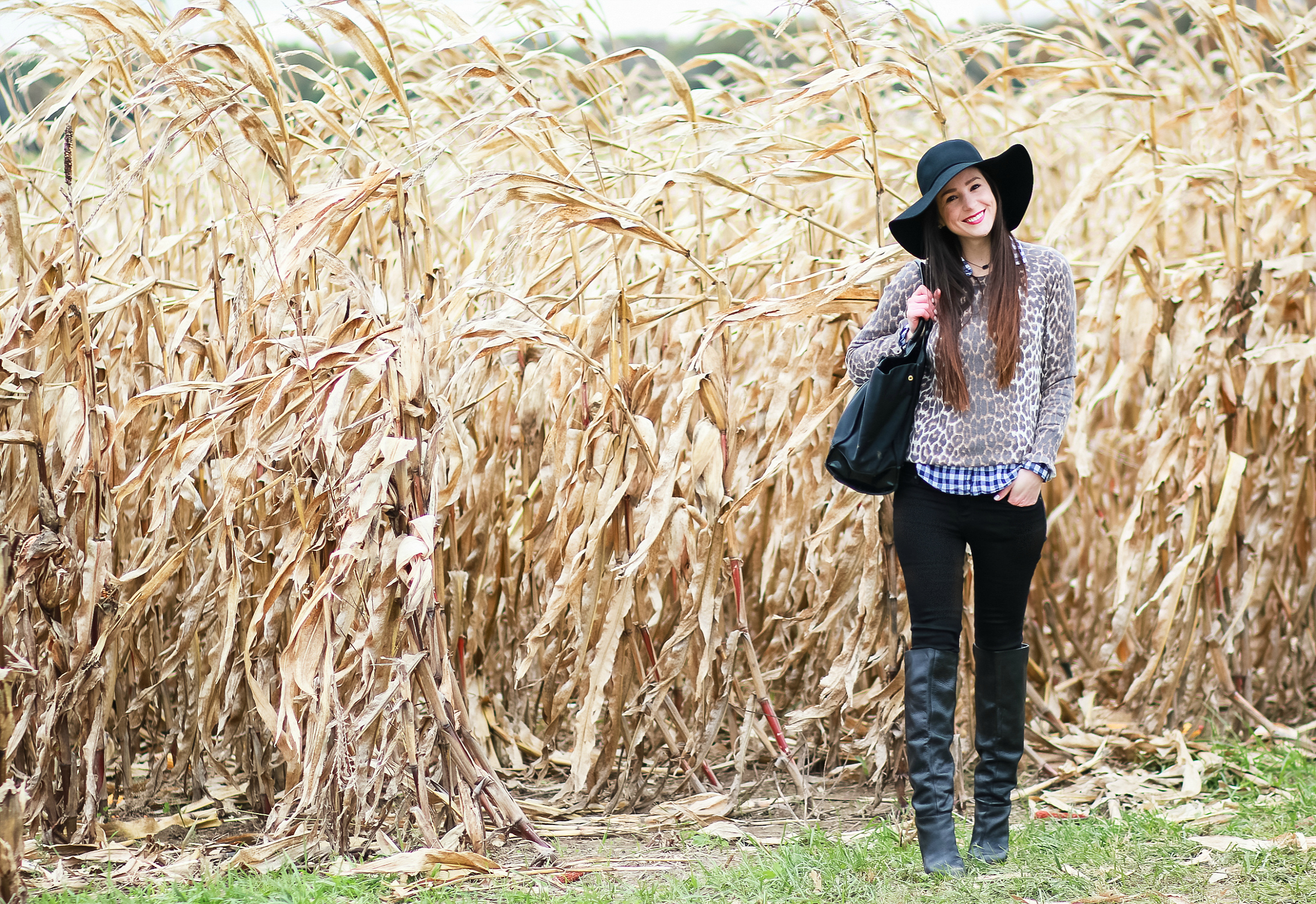 Black floppy hat with leopard crewneck sweater, J.Crew Factory blue gingham button down, black jeans, Nine West tall black boots, and a Tory Burch Ella tote | Comfy and casual fall outfit idea | How to wear a floppy hat in the fall by fashion blogger Stephanie Ziajka from Diary of a Debutante