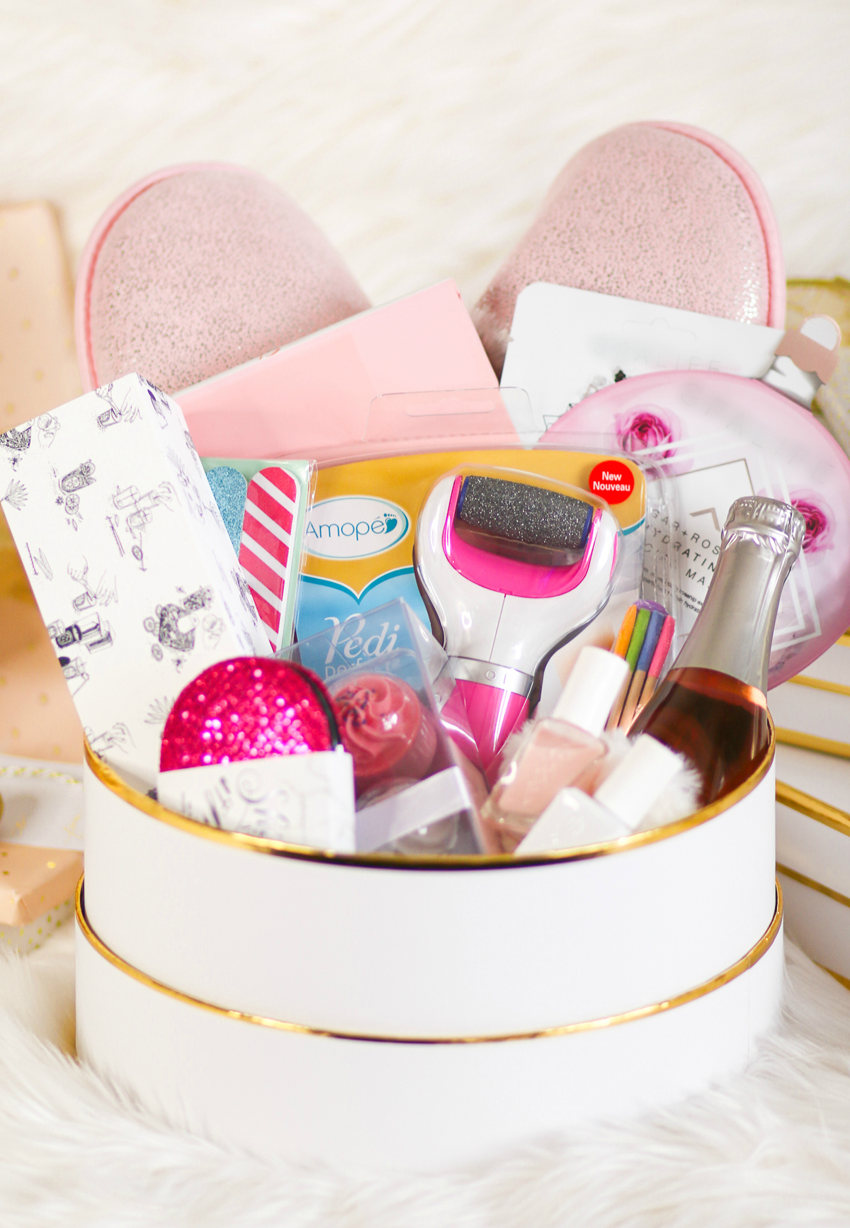 DIY spa gift basket consisting of 12 self care gift ideas she's guaranteed to love, including the Amope Pedi Perfect Foot File, by southern blogger Stephanie Ziajka from Diary of a Debutante