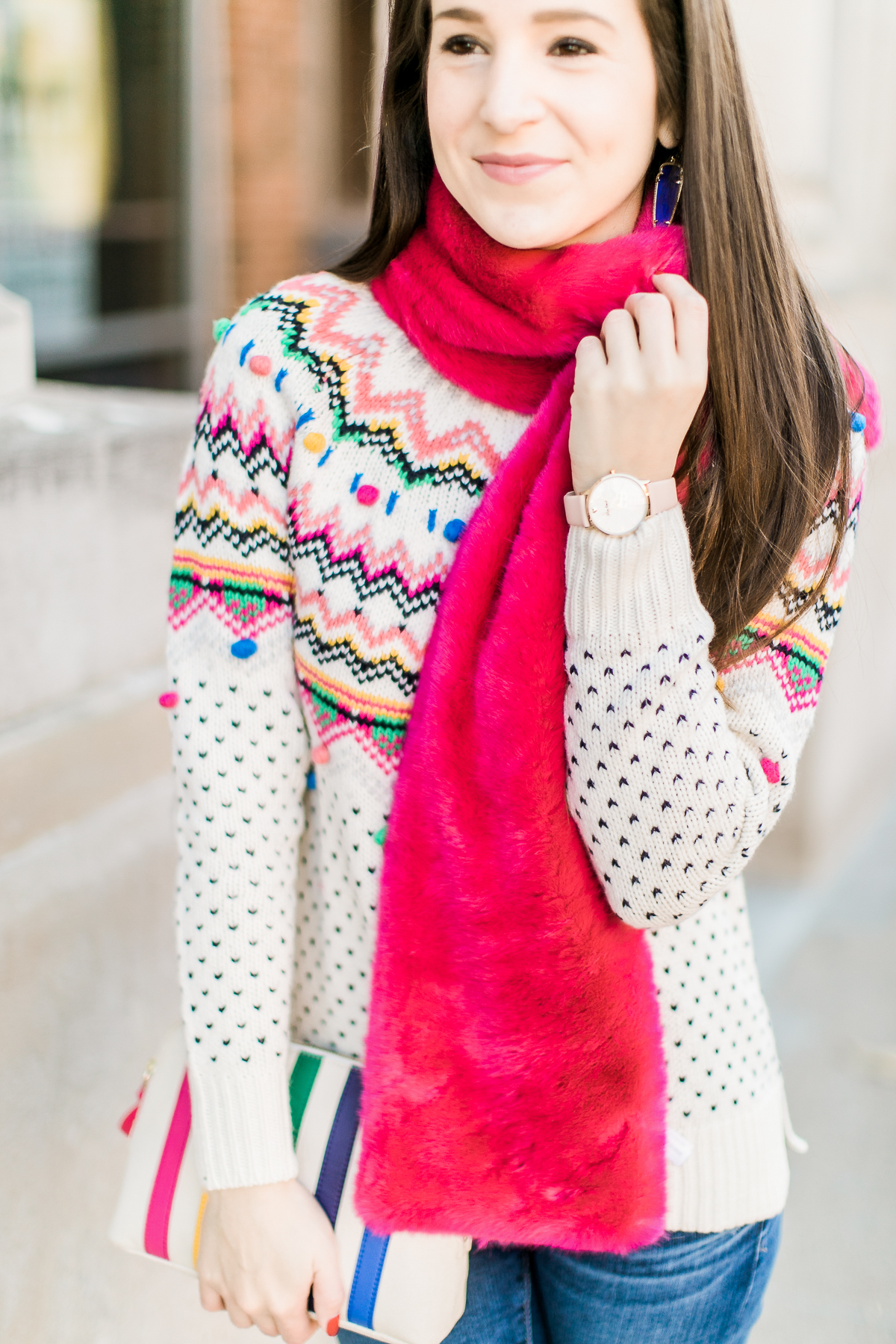 Colorful Christmas sweater ideas from Talbots, featuring their Carnival Fair Isle Sweater, Pink Faux Fur Pull Through Scarf, and Canvas Stripe Makeup Pouch styled with AG the Legging ankle jeans, taupe Free People Liberty boots, and cognac Kendra Scott Skylar earrings by southern fashion blogger Stephanie Ziajka from Diary of a Debutante