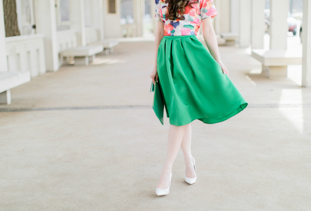 Why We Should Embrace Modesty in Modern Fashion by southern fashion blogger Stephanie Ziajka from Diary of a Debutante, kelly green a-line skirt styled with a colorful calico print crop top, white pointed toe pumps, and a green monogrammed GiGi New York Uber clutch, modest outfit for women, modest dresses and skirts for women